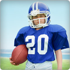 Child with football helmet to avoid concussions